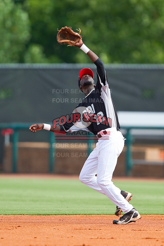 Second baseman DeJohn Suber #12 of RBI tracks a fly ball against American Legion at the 2011 Tournament of Stars at the USA Baseball National Training Center on June 25, 2011 in Cary, North Carolina.  RBI defeated American Legion by the score of 8-7. (Brian Westerholt/Four Seam Images)