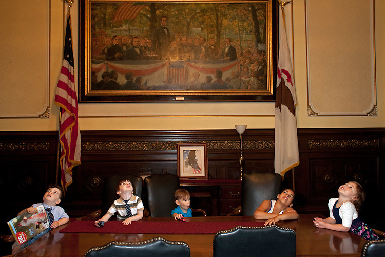 After testifying about the need for greater funding for children's cancer research before the Illinois House Revenue and Finance Committee with her mother, Laura, Atia Lutarewych, 4, far right, and her friends and relatives get an eyeful of Governor Pat Quinn's office in the State Capitol in Springfield. Atia and her mother are both cancer survivors. They were promoting House Bill 4211, which would allow taxpayers to donate money to The Childhood Cancer Research Fund through a charitable deduction check-off box on their state tax form. Laura Lutarewych testified that childhood cancer receives about 4% of the national cancer research budget. She pointed out that when life spans are taken into consideration, under the current allotment to pediatric cancer research, a childs life is valued at $940 a year, and an adults life is valued at over $10,000 per year.