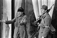 """ROMANIA, Calea Victoriei, Bucharest, 23.12.1989<br /> People rise against Ceausescu. The dictator has fled the city on dec. 22. Weird statements at the Tanase theatre about existing or non-existing """"terrorists"""". At any rate, shooting is going on in the city.<br /> © Andrei Pandele / EST&OST"""
