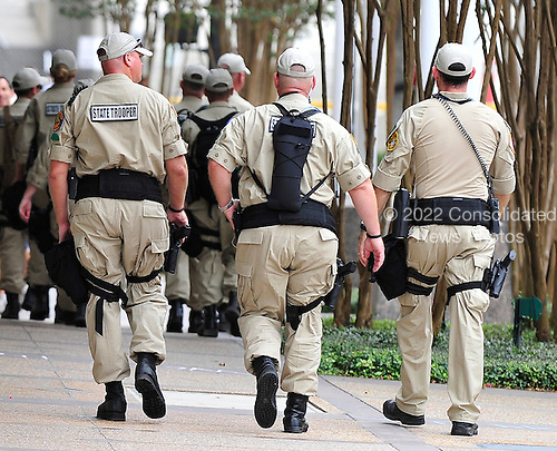 State Troopers patrol the streets near the 2012 Republican National Convention in Tampa Bay, Florida on Saturday, August 25, 2012..Credit: Ron Sachs / CNP.(RESTRICTION: NO New York or New Jersey Newspapers or newspapers within a 75 mile radius of New York City)