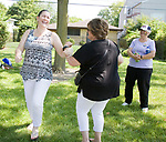 "Janine Foy Witko and a neighbor dance to ""It's a Wonderful World"" during the Family Peace Fest for Hope and Harmony, in Morton Grove, Saturday, August 19, 2017. [Photo by Karen Kring]"