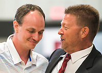 NWA Democrat-Gazette/CHARLIE KAIJO Hon. Thomas Smith (from right) hugs graduate Scotty Price during the Adult Drug Court and Veterans Treatment Court graduation, Friday, June 8, 2018 at the Church of Christ in Bentonville. <br /><br />Some participants in Benton County&acirc;&euro;&trade;s drug and veterans court graduated from the program, their largest class. A ceremony was held Friday and Lt. Governor Tim Griffith was the guest speaker.