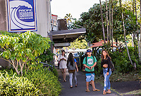 Local teenagers wait near the Pacific Tsunami Musuem in downtown Hilo, Big Island of Hawai'i.