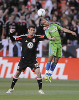Seattle Sounders forward David Estrada (16) heads the ball while cover by D.C. United defender Emiliano Dudar (19) D.C. United tied the Seattle Sounders, 0-0 at RFK Stadium, Saturday April 7, 2012.