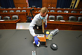 The area around the name tag for the Director of the National Institute for Allergy and Infectious Diseases Dr. Anthony Fauci is sanitized before he arrives to testify before the House Committee on Energy and Commerce on the Trump Administration's Response to the COVID-19 Pandemic, on Capitol Hill in Washington, DC on Tuesday, June 23, 2020.  <br /> Credit: Kevin Dietsch / Pool via CNP
