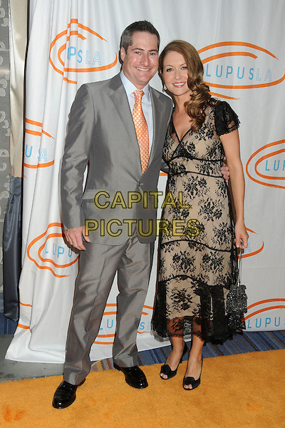 Adam Selkowitz, Ali Hillis.12th Annual Lupus LA Orange Ball held at the Beverly Wilshire Hotel, Beverly Hills, California, USA..May 24th, 2012.full length black beige dress lace grey gray suit.CAP/ADM/BP.©Byron Purvis/AdMedia/Capital Pictures.
