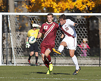 Virginia Tech midfielder Niels Kirch (10) clears the ball as Boston College forward Cole DeNormandie (23) defends.Boston College (maroon) defeated Virginia Tech (Virginia Polytechnic Institute and State University) (white), 3-1, at Newton Campus Field, on November 3, 2013.