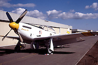 """Legendary pilot Bob Love's P-51 Mustang """"Bernie's Bo"""" sits in front of the hangar ready for flight. Bob was an instructor pilot in the P-38 lightning during the World War II and became an ace in the Korean War flying the F-86 Sabre. Bob also participated regularly at the Reno Air Races each September. Bob passed away in the fall of 1986 and his Mustang since been owned by Russ Francis, Bill Dause, and is now owned by Dream Machines LLC."""