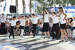 Boys and girls dancing a Greek folk dance at the Los Angeles Greek Festival at St. Sophia's Greek Orthodox Church in Los Angeles, CA