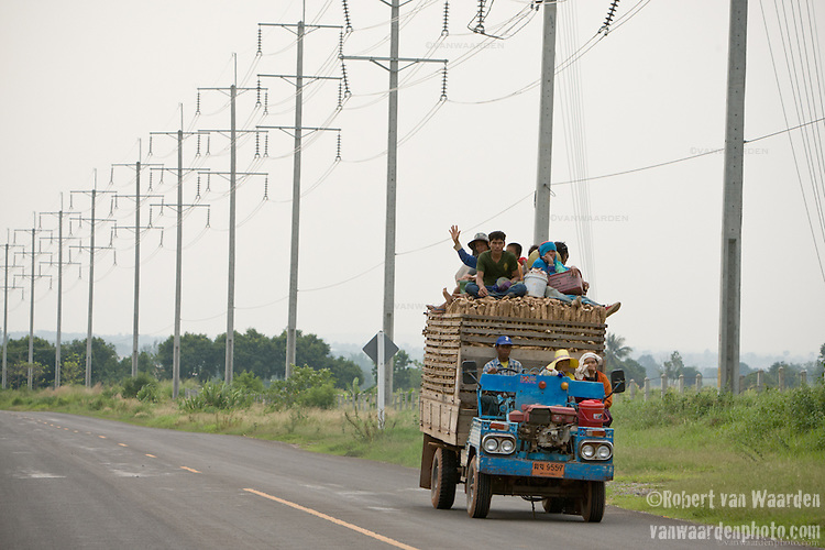 A truck full of farm produce drives down one of the newly paved roads thanks to the wind farm from Wind Energy Holdings. The wind farm in the Nakhon Ratchasima district is the largest in Thailand.