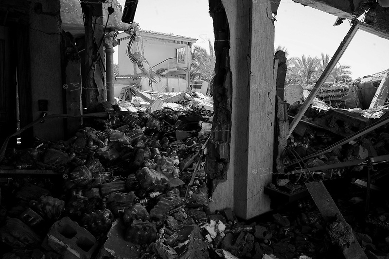 Surman, Libya, June 20, 2011.At around 4AM, NATO bombs almost completely flattened an extensive complex of five villas belonging to Major Genral El Khweldi El Hamedi, alledgedly used as a military control and command center. Among the victims were members of his family including 3 childrens, but he himself survived the bombing.