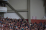 West Ham United 2 Crystal Palace 2, 02/04/2016. Boleyn Ground, Premier League. Home fans in the Betway Stand watching the first-half action at the Boleyn Ground as West Ham United hosted Crystal Palace in a Barclays Premier League match. The Boleyn Ground at Upton Park was the club's home ground from 1904 until the end of the 2015-16 season when they moved into the Olympic Stadium, built for the 2012 London games, at nearby Stratford. The match ended in a 2-2 draw, watched by a near-capacity crowd of 34,857. Photo by Colin McPherson.