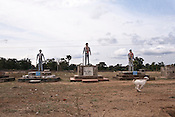 Statues of soldiers are erected, and are garlanded to pay tribute by local government by the side of the highway in Chattisgarh, India. Photo: Sanjit Das/Panos for Forbes