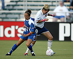 Aly Wagner (10) moves past Staci Burt (3) at SAS Stadium in Cary, North Carolina on 7/19/03 during a game between the Carolina Courage and San Diego Spirit. Carolina won the game 1-0