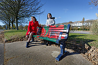 Pictured: Clare Mitchell with Sophie, 9 by one of the benches. Sunday 28 October 2018 <br /> Re: Poppies have been painted on benches near the Cenotaph, to commemorate 100 years from the end of the second World War in 1918, Swansea, Wales, UK.
