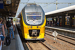 Train arriving at platform of railway station, Nijmegen, Gelderland, Netherlands