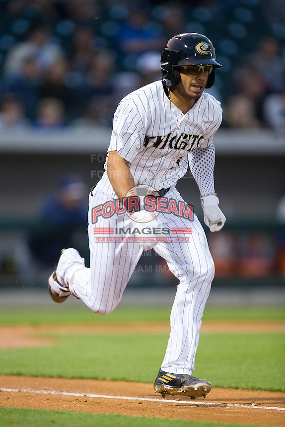 Jacob May (3) of the Charlotte Knights hustles down the first base line against the Durham Bulls at BB&T BallPark on April 14, 2016 in Charlotte, North Carolina.  The Bulls defeated the Knights 2-0.  (Brian Westerholt/Four Seam Images)