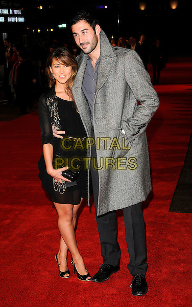 "RACHEL STEVENS & ALEX BOURNE.2009 London Film Festival - Times Gala & the UK Premiere of ""The Men Who Stare At Goats"" at the Odeon, Leicester Square, London, England. .October 15th 2009 .full length married husband wife black dress waist belt peep toe shoes sequined sequins shrug cardigan chanel bag grey gray coat hand in pocket slingbacks .CAP/CAN.©Can Nguyen/Capital Pictures."
