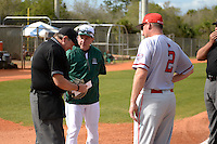 Dartmouth Big Green head coach Bob Whalen and Rich Maloney (2) exchange lineup cards with umpire Jerry Fowler before a game against the Ball State Cardinals on March 7, 2015 at North Charlotte Regional Park in Port Charlotte, Florida.  Ball State defeated Dartmouth 7-4.  (Mike Janes/Four Seam Images)