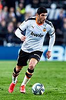 14th February 2020; Mestalla, Valencia, Spain; La Liga Football,Valencia versus Atletico Madrid; Guedes of Valencia CF brings the ball forward