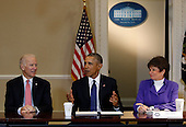 United States President Barack Obama speaks during a meeting of the Democratic Governors Association while Vice President Joe Biden (L) and  Senior Advisor to the President Valerie Jarrett (R) listen,  in the Eisenhower Executive Office Building, at the White House, Washington, DC, February 19, 2016.  <br /> Credit: Aude Guerrucci / Pool via CNP