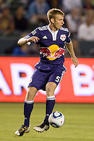 New York Red Bulls defender Tim Ream looking downfield for an open man. The New York Red Bulls beat the LA Galaxy 2-0 at Home Depot Center stadium in Carson, California on Friday September 24, 2010.