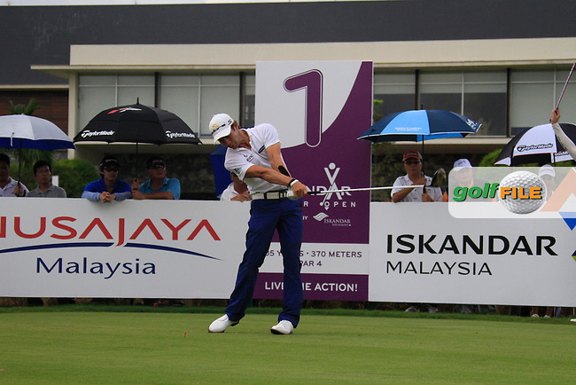 Manny Villegas (COL) tees off on the 1st tee to start his match during Saturday's storm delayed  Round 3 of the Iskandar Johor Open 2011 at the Horizon Hills Golf Resort Johor, Malaysia, 19th November 2011 (Photo Eoin Clarke/www.golffile.ie)
