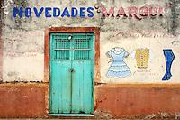 Storefront and old wooden door in Santa Elena, Yucatan, Mexico.