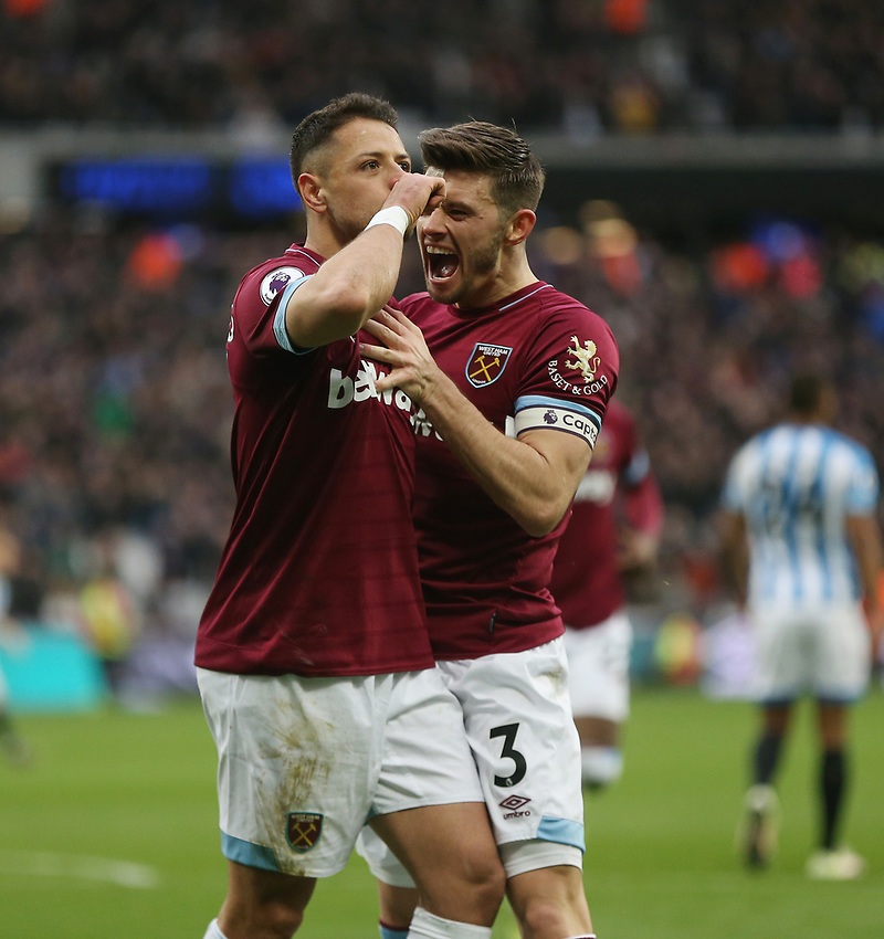 West Ham United's Javier Hernandez celebrates scoring his side's third goal with Aaron Cresswell<br /> <br /> Photographer Rob Newell/CameraSport<br /> <br /> The Premier League - West Ham United v Huddersfield Town - Saturday 16th March 2019 - London Stadium - London<br /> <br /> World Copyright © 2019 CameraSport. All rights reserved. 43 Linden Ave. Countesthorpe. Leicester. England. LE8 5PG - Tel: +44 (0) 116 277 4147 - admin@camerasport.com - www.camerasport.com