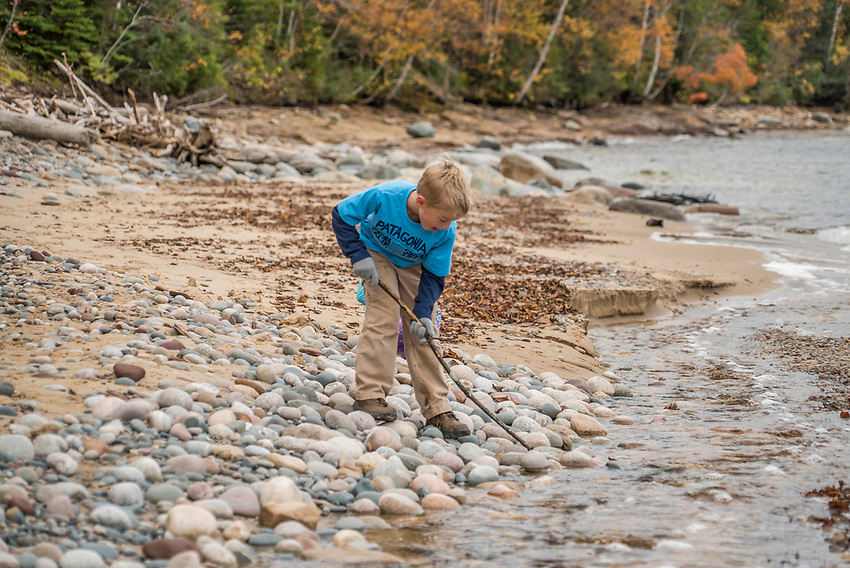 Family hike along Lake Superior at Pictured Rocks National Lakeshore in fall.