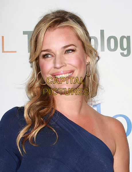 REBECCA ROMIJN .First Annual Global Action Forum Gala Held At The Beverly Hilton Hotel, Beverly Hills, California, USA, .18th Febuary 2011..portrait headshot smiling  one shoulder sleeve blue .CAP/ADM/KB.©Kevan Brooks/AdMedia/Capital Pictures.