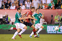 Robbie Rogers (16) of the United States gets behind Gerardo Torrado (6)  of Mexico. The men's national teams of the United States (USA) and Mexico (MEX) played to a 1-1 tie during an international friendly at Lincoln Financial Field in Philadelphia, PA, on August 10, 2011.
