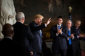 U.S. President Donald Trump waves during a congressional Gold Medal ceremony for former Senator Bob Dole, in Washington D.C., U.S., on Wednesday, Jan. 17, 2018. From left: U.S. Vice President Mike Pence, Trump, U.S. House Speaker Paul Ryan, a Republican from Wisconsin, Senate Majority Leader Mitch McConnell, a Republican from Kentucky, and Senate Minority Leader Chuck Schumer, a Democrat from New York. Photographer: Al Drago/Bloomberg<br /> Credit: Al Drago / Pool via CNP