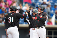 Quad Cities River Bandits first baseman Connor Goedert (8) high fives Pat Porter (31) after hitting a home run during a game against the Burlington Bees on May 9, 2016 at Modern Woodmen Park in Davenport, Iowa.  Quad Cities defeated Burlington 12-4.  (Mike Janes/Four Seam Images)
