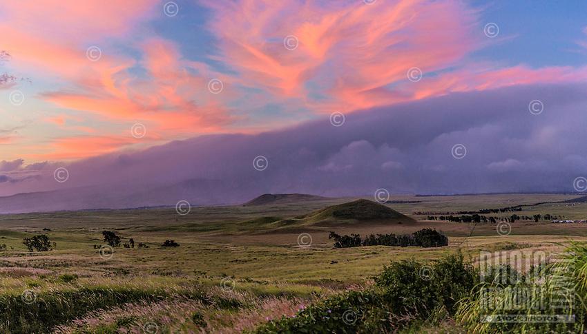 A sunset with pink and purple clouds over Mauna Kea, Big Island.