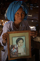 Daw Aye Than a 65 year old women with an old photo of her from the traditional Minnanthu Village near Bagan, Myanmar/Burma