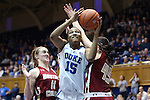 27 January 2013: Duke's Richa Jackson (15) shoots past Boston College's Nicole Boudreau (11) and Katie Zenevitch (45). The Duke University Blue Devils played the Boston College Eagles at Cameron Indoor Stadium in Durham, North Carolina in an NCAA Division I Women's Basketball game. Duke won the game 80-56.