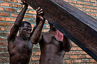 Colombian workers lift a heavy timber from the Pacific rainforest at a sawmill in Tumaco, Colombia, 18 June 2010. Tens of sawmills located on the banks of the Pacific jungle rivers generate almost half of the Colombia's wood production. The wood species processed here (sajo, machare, roble, guabo, cargadero y pacora) are mostly used in the construction industry and the paper production. Although the Pacific lush rainforest in Colombia is one of the most biodiverse area of the world, the region suffers an extensive deforestation due to the uncontrolled logging in the last years.
