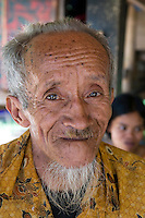 Rantepao, Tana Toraja, Sulawesi, Indonesia, October 2010.  An old Torajan man in his family home in Tampangallo. When a Torajan dies in Toraja land, family members of the deceased are required to hold a series of funeral ceremonies that usually last for several days before the deceased is brought to a funeral site for burial. The Toraja people live a traditional life in the forested mountains of South Sulawesi.  Photo by Frits Meyst/Adventure4ever.com