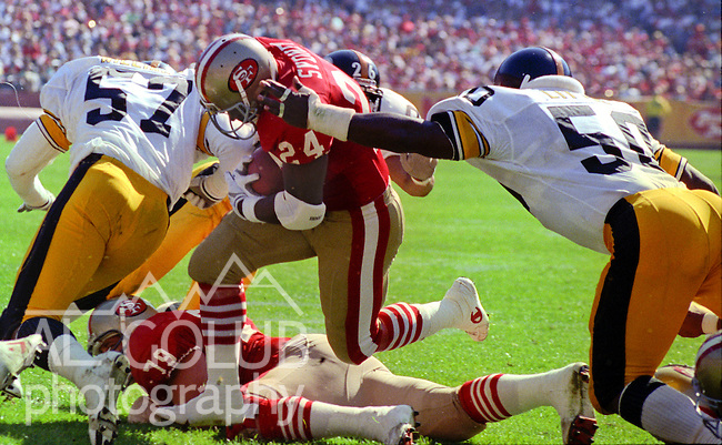 San Francisco 49ers vs Pittsburg Steelers at Candlestick Park Sunday, October 21, 1990..49ers beat Steelers 27-7.49r running back Harry Sydney (24) pushes forward...