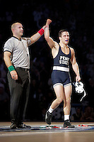 STATE COLLEGE, PA - FEBRUARY 8: Garett Hammond of the Penn State Nittany Lions gets his hand raised after defeating Nick Moore of the Iowa Hawkeyes after their match on February 8, 2015 at the Bryce Jordan Center on the campus of Penn State University in State College, Pennsylvania. The Hawkeyes won 18-12. (Photo by Hunter Martin/Getty Images) *** Local Caption *** Garett Hammond