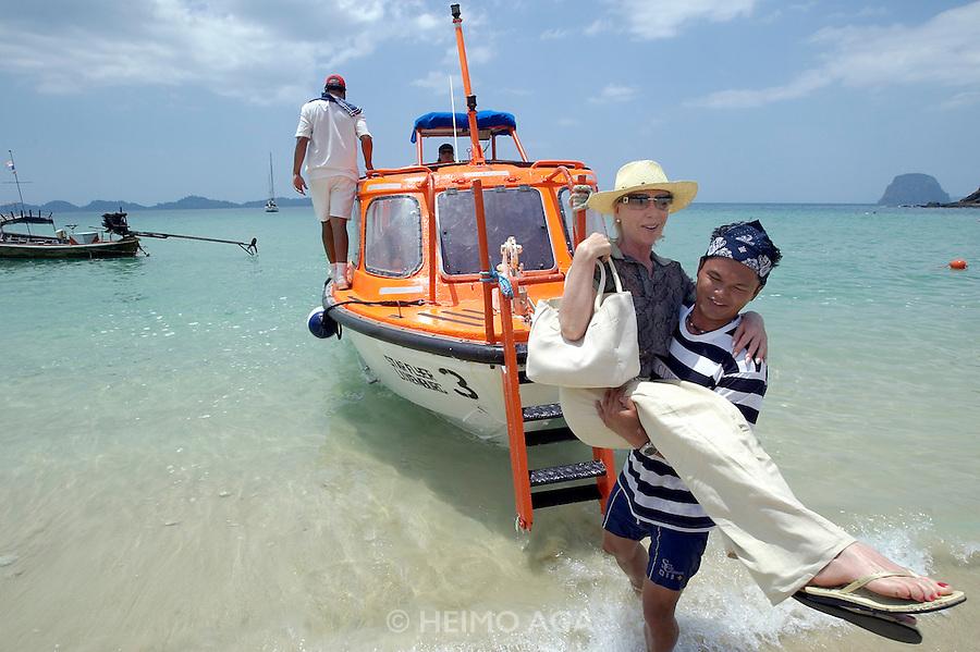 The Star Flyer anchoring at Ko Muk. Passengers going ashore by tender boat. Rosemarie.