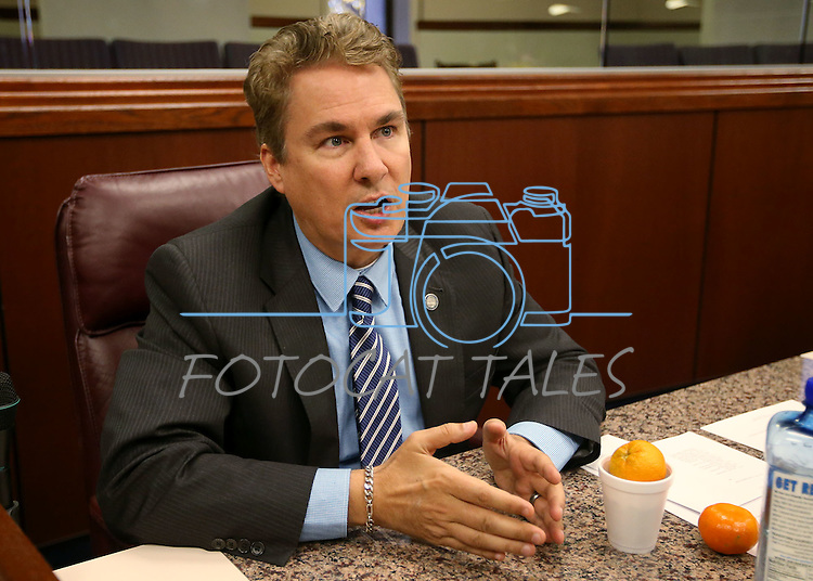 Nevada Assemblyman Brent Jones, R-Las Vegas, answers media questions on the Assembly floor at the Legislative Building in Carson City, Nev., on Monday, April 27, 2015. <br /> Photo by Cathleen Allison