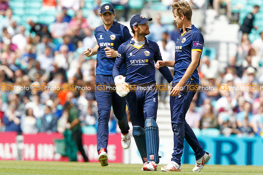 Matt Quinn (r) is congratulated by James Foster (c) on taking the wicket of Dwayne Bravo (caught Ryan ten Doeschate) during Surrey vs Essex Eagles, Nat West T20 Blast Cricket at the Kia Oval on 25th June 2016