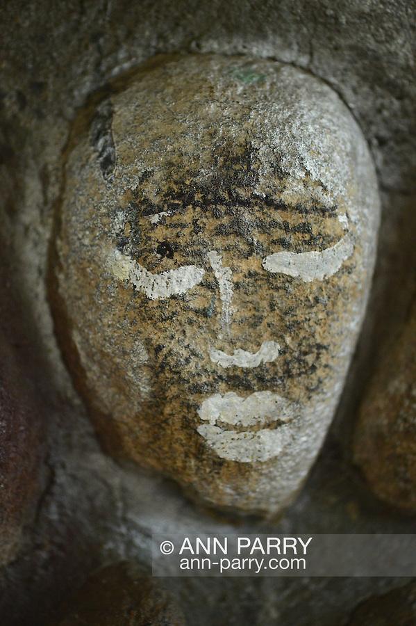 Stone with face grafitti inside Gazebo at Heckscher Park, on November 8, 2014, at Huntington, Long Island, New York, USA