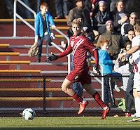 Boston College defender Amit Shumowitz (20) dribbles down the wing.Boston College (maroon) defeated Virginia Tech (Virginia Polytechnic Institute and State University) (white), 3-1, at Newton Campus Field, on November 3, 2013.