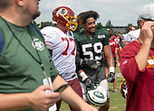 New York Jets linebacker Frankie Luvu (59) and Washington Redskins offensive guard Shawn Lauvao (77) walk off the field together after participating in a joint training camp practice with the Washington Redskins at the Washington Redskins Bon Secours Training Facility in Richmond, Virginia on Monday, August 13, 2018.<br /> Credit: Ron Sachs / CNP<br /> (RESTRICTION: NO New York or New Jersey Newspapers or newspapers within a 75 mile radius of New York City)