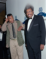 ARCHIVE: LOS ANGELES, CA: 14th April 1989: Mike Tyson & Don King at the Soul Train Music Awards.<br /> File photo © Paul Smith/Featureflash