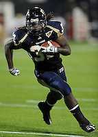 22 November 2008:  FIU running back Julian Reams (32) attempts to turn the corner towards the end zone in the ULM 31-27 victory over FIU at FIU Stadium in Miami, Florida.