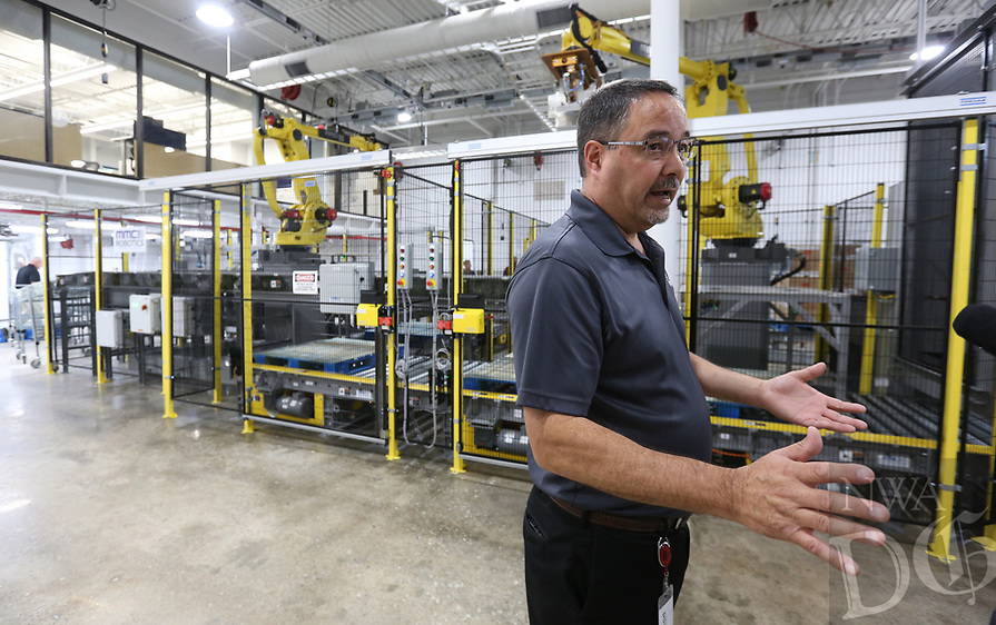 NWA Democrat-Gazette/DAVID GOTTSCHALK Marty Linn, director of Tyson Foods Manufacturing and Automation Center, describes Thursday, August 8, 2019, the Palletizing and Material Management System following an unveiling ceremony at the new Tyson Foods Manufacturing and Automation Center in Springdale. The center will provide space for the development of new manufacturing solutions, collaboration with equipment suppliers and worker training on new technology.